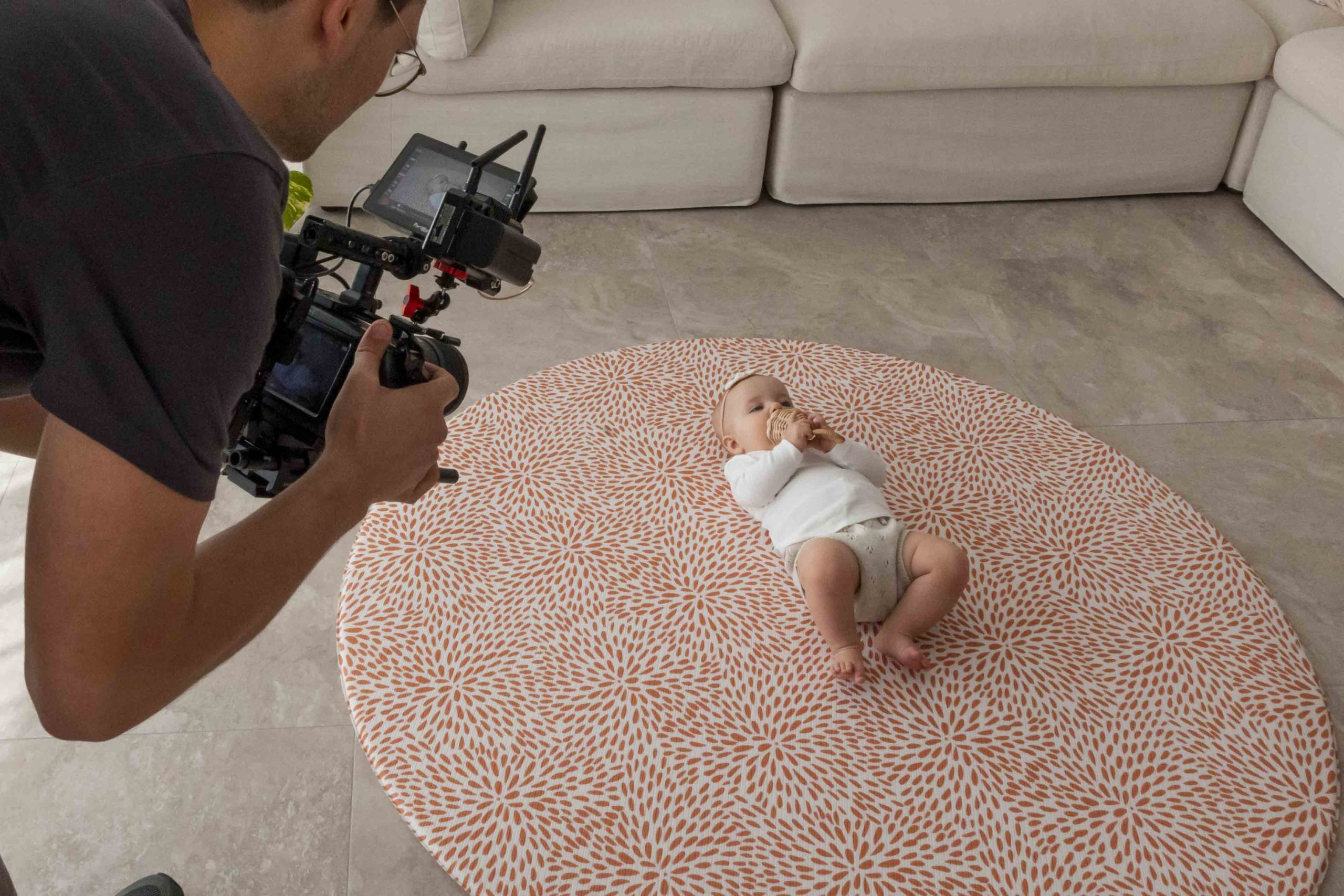Baby on a Luxe at Plays mat while AOV Films is filming