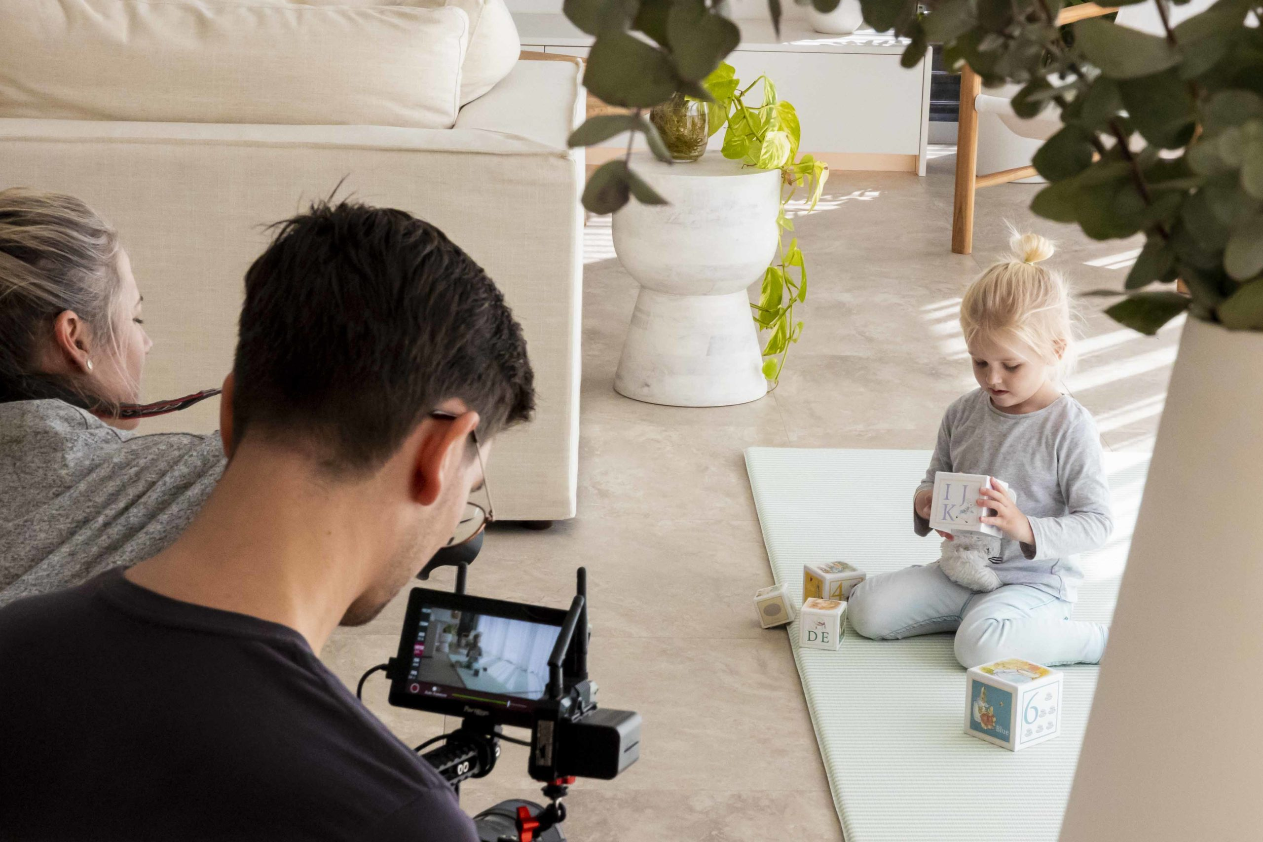 Kid playing on a Luxe at Plays mat while AOV Films is filming a commercial